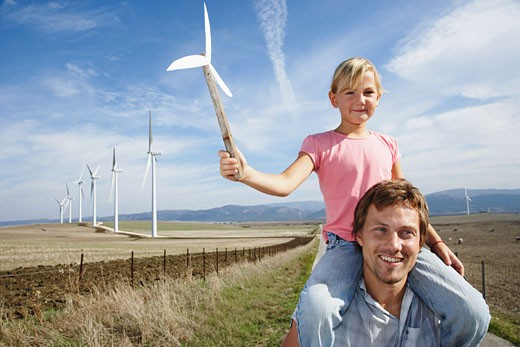 Father and Daughter with Wind Turbines    : Stock Photo