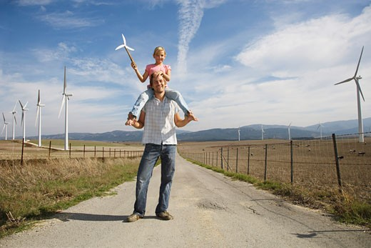 Stock Photo: 1828R-34958 Father and Daughter with Wind Turbines