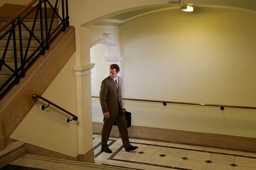 Stock Photo: 1828R-34984 Businessman Walking in Hallway