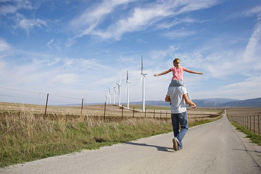 Young Girl on Father's Shoulders    : Stock Photo