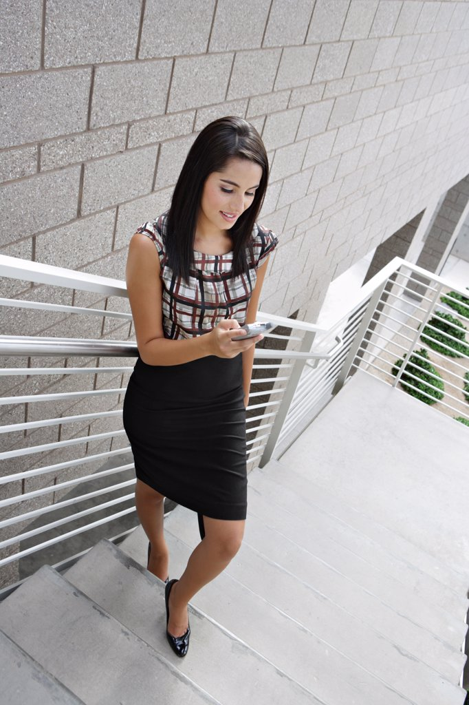 Stock Photo: 1828R-35275 Businesswoman Reading Text Message