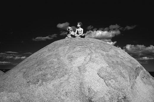 Boy and Dog Sitting on Boulder    : Stock Photo