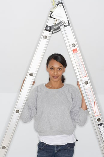 Stock Photo: 1828R-35472 Woman Standing by Ladder