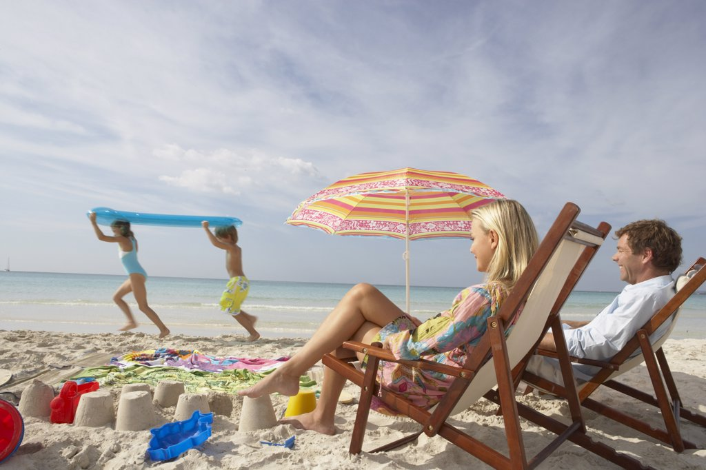 Stock Photo: 1828R-35494 Parents Watching Children Play on Beach, Majorca, Spain