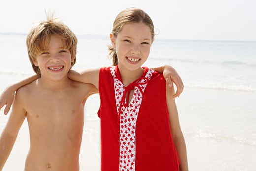 Portrait of Brother and Sister on Beach, Majorca, Spain    : Stock Photo