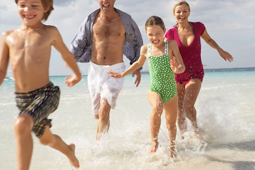 Family Running along Beach, Majorca, Spain    : Stock Photo