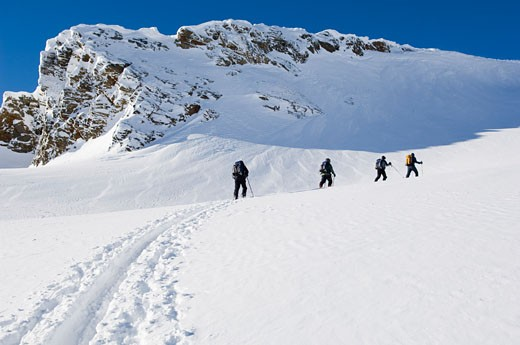 Stock Photo: 1828R-35757 Skiers on Mountainside, Selkirk Mountains, British Columbia, Canada