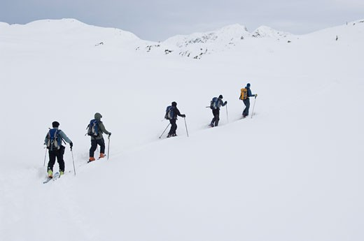 Stock Photo: 1828R-35760 Skiers on Mountainside, Selkirk Mountains, British Columbia, Canada
