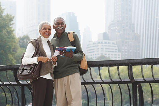 Stock Photo: 1828R-35783 Couple in City with Travel Guide, New York City, New York, USA