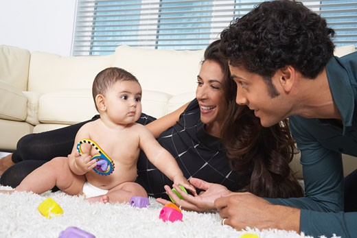 Stock Photo: 1828R-35989 Parents Playing With Baby