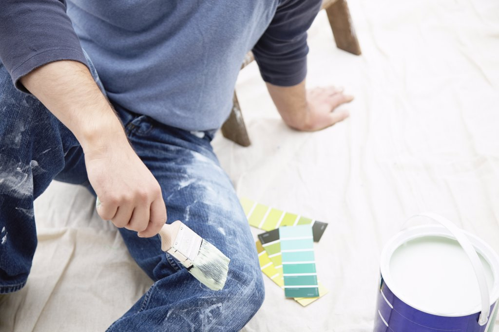 Stock Photo: 1828R-36683 Painter with Paint Can and Swatches