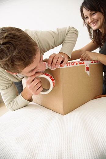 Couple Packing Box in Bedroom    : Stock Photo