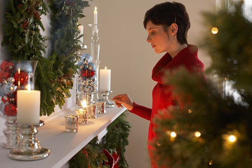 Woman Lighting Candles    : Stock Photo