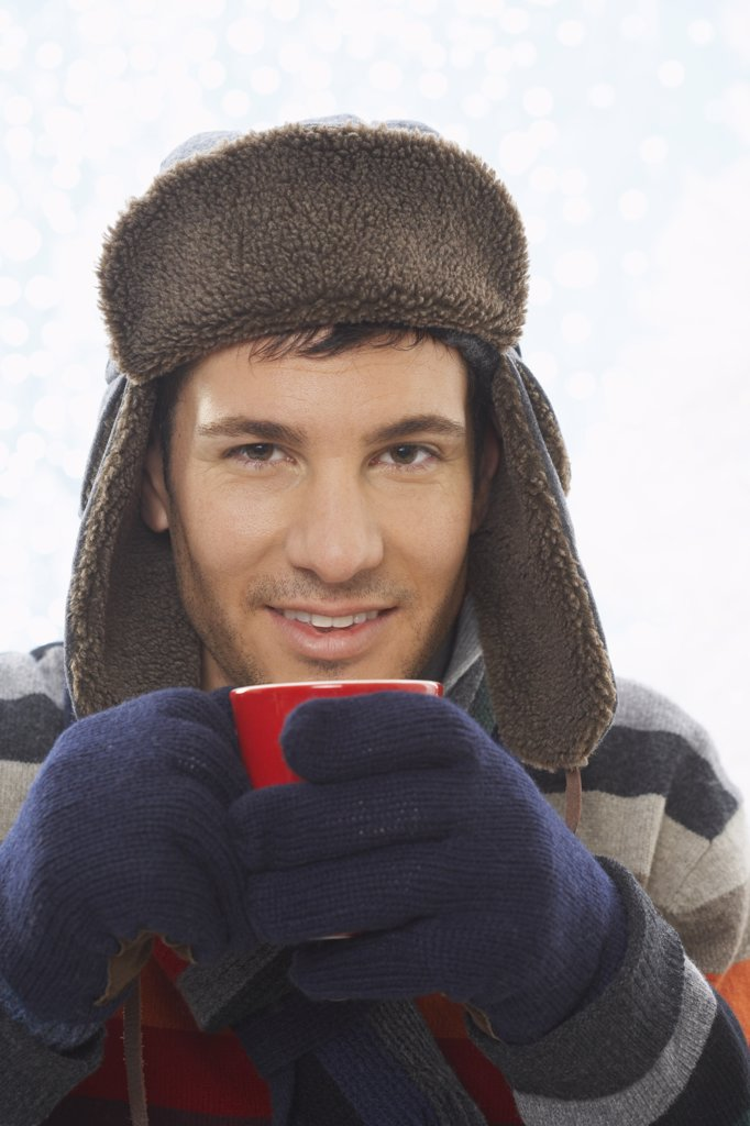 Stock Photo: 1828R-37455 Man Drinking Hot Chocolate