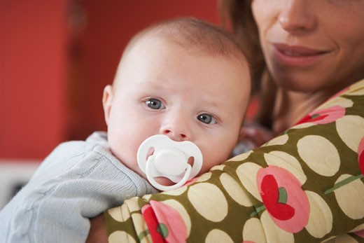 Stock Photo: 1828R-37988 Mother with Baby