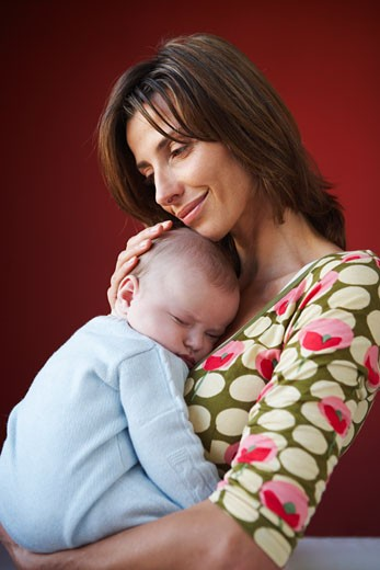 Stock Photo: 1828R-37993 Mother with Baby