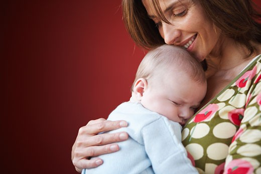 Stock Photo: 1828R-37996 Mother with Baby
