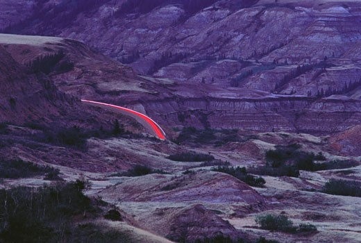 Stock Photo: 1828R-3822 Light Trails on Road in Canyon Red Deer, River Valley, Alberta Canada