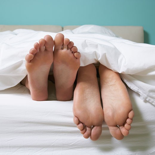 Couple's Feet in Bed    : Stock Photo