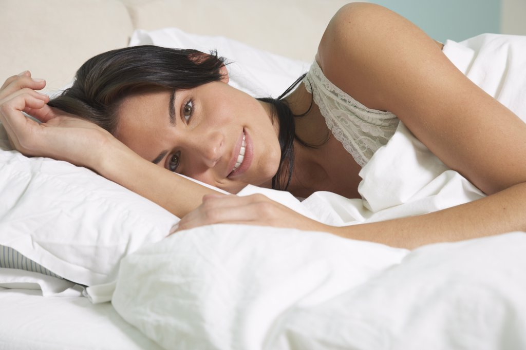 Stock Photo: 1828R-38418 Woman in Bed