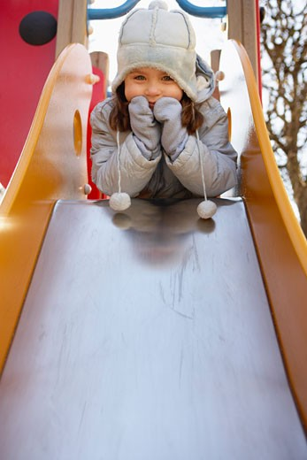 Stock Photo: 1828R-38699 Little Girl on the Slide at the Playground, Paris, France