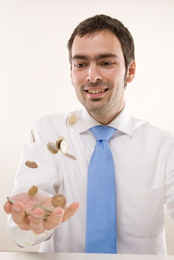 Stock Photo: 1828R-38906 Man Tossing Coins