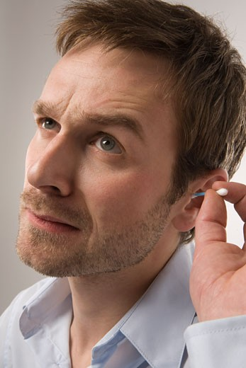 Man Cleaning Ears    : Stock Photo
