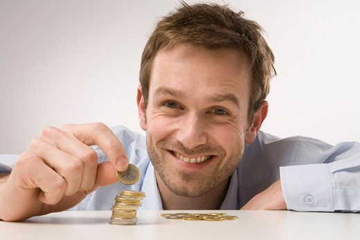 Stock Photo: 1828R-38935 Man Counting Coins