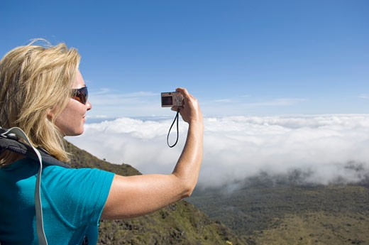 Stock Photo: 1828R-39160 Woman Photographing Self, Haleakala Crater, Maui, Hawaii, USA