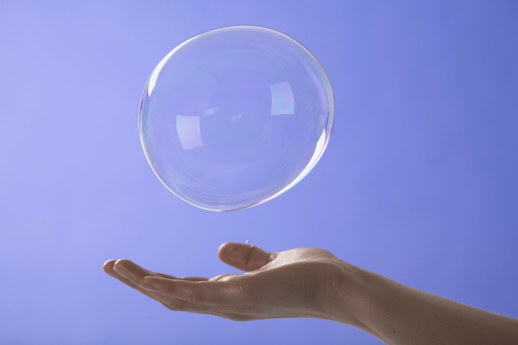 Stock Photo: 1828R-39201 Woman Reaching for Bubble
