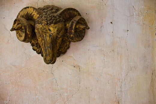 Stock Photo: 1828R-39755 Sculpture of Ram's Head on Wall