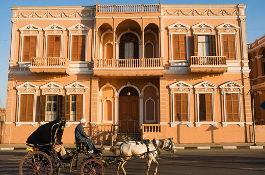 Stock Photo: 1828R-39839 Horse-Drawn Carriage by Colonial Building, Luxor, Egypt
