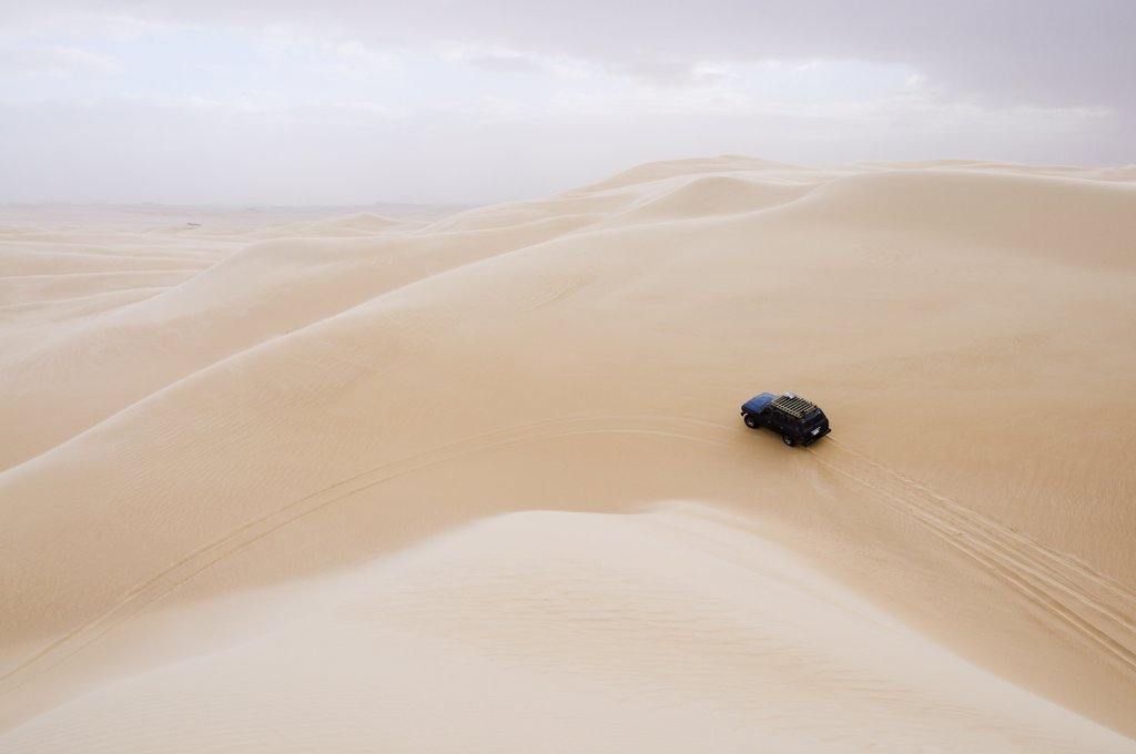 Stock Photo: 1828R-39862 Jeep on Dune, Libyan Desert, Egypt