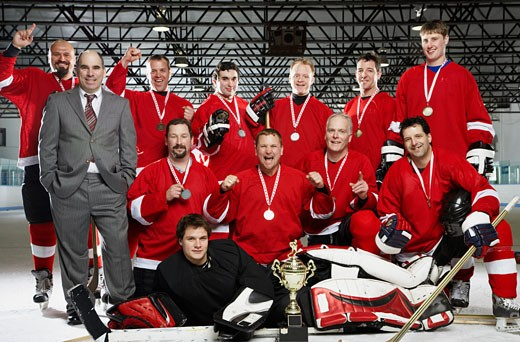 Stock Photo: 1828R-40238 Portrait of Hockey Team With Trophy and Medals
