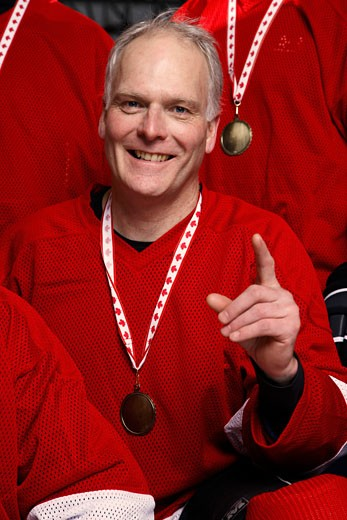 Portrait of Hockey Player Wearing Medal    : Stock Photo