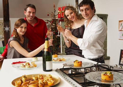 Stock Photo: 1828R-40322 Friends Celebrating Christmas