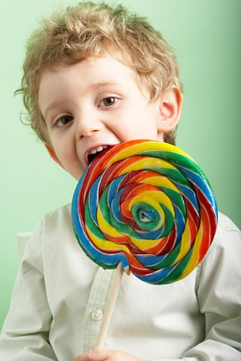 Boy Eating Lollipop    : Stock Photo