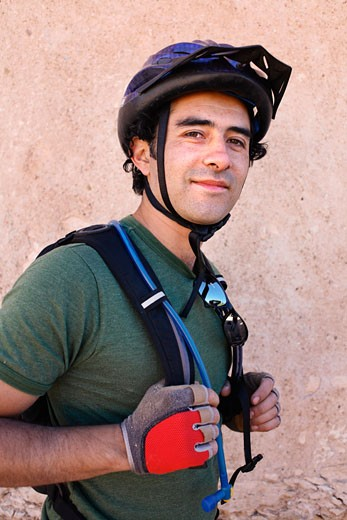 Stock Photo: 1828R-40600 Portrait of Man Wearing Bicycle Helmet, Pozos, Mexico