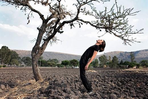Man Bending in the Shape of a Tree, San Miguel de Allende, Guanajuato, Mexico    : Stock Photo