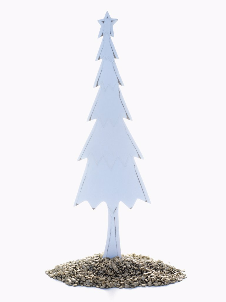 Stock Photo: 1828R-41314 Wooden Christmas Tree Standing in Pile of Golden Rocks