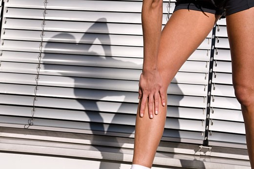 Close-up of Women's Legs, Warming Up Before Jogging    : Stock Photo