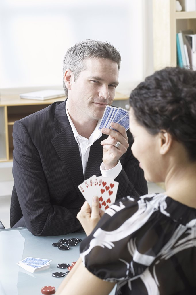 Stock Photo: 1828R-42052 Business People Playing Poker