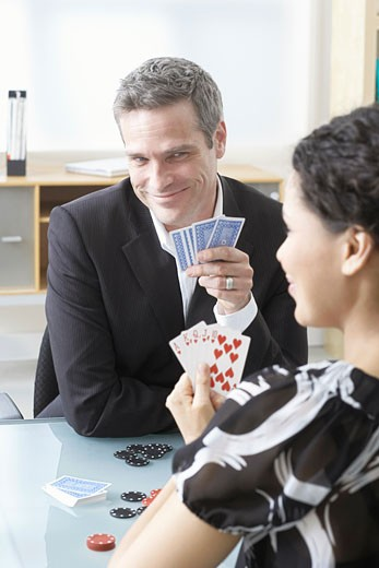Stock Photo: 1828R-42053 Business People Playing Poker