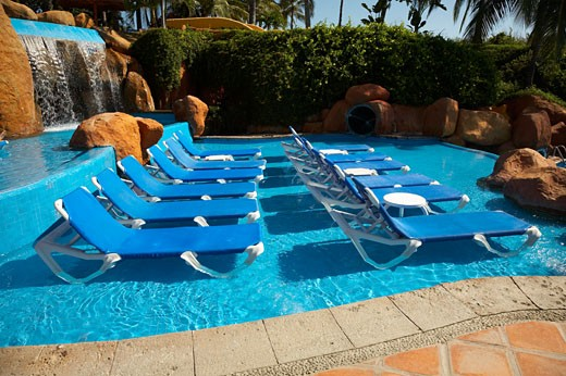 Stock Photo: 1828R-42399 Lounge Chairs in Swimming Pool, Fairmont Rancho Banderas, Bahia de Banderas, Nayarit, Mexico