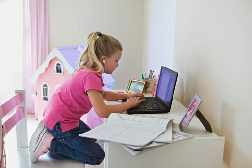 Stock Photo: 1828R-42506 Girl Doing Her Homework