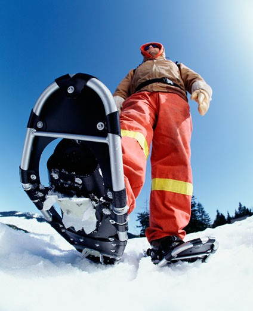 Man Wearing Snowshoes    : Stock Photo