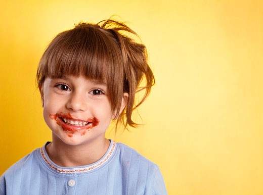Stock Photo: 1828R-42524 Portrait of Girl With Spaghetti Sauce on Face