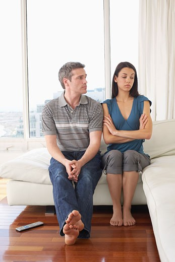 Stock Photo: 1828R-42999 Couple on Sofa in Condominium