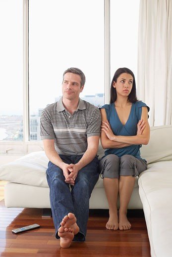 Stock Photo: 1828R-43000 Couple on Sofa in Condominium