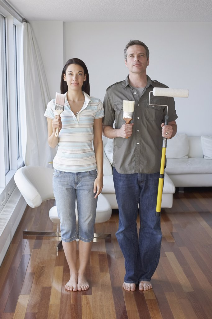 Stock Photo: 1828R-43021 Couple in Apartment with Painting Supplies